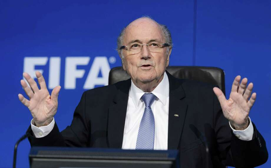 "FILES - A picture taken on July 20, 2015 shows FIFA president Sepp Blatter gesturing during a press conference at the FIFA world-body headquarter's in Zurich. Embattled FIFA chief Joseph Blatter is suspected of ""disloyal payment"" to UEFA head Michel Platini, who had hoped to succeed him, the office of Switzerland's attorney general said on September 25, 2015. AFP PHOTO / FABRICE COFFRINIFABRICE COFFRINI/AFP/Getty Images ORG XMIT: - Photo: FABRICE COFFRINI / AFP"