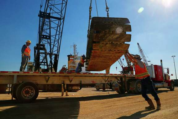 Heavy equipment is loaded onto a truck at Intermarine's Industrial Terminals facility along the Houston Ship Channel, Wednesday, Sept. 23, 2015. The company ships cargo for projects backed by the Export-Import Bank, among others. ( Mark Mulligan / Houston Chronicle )
