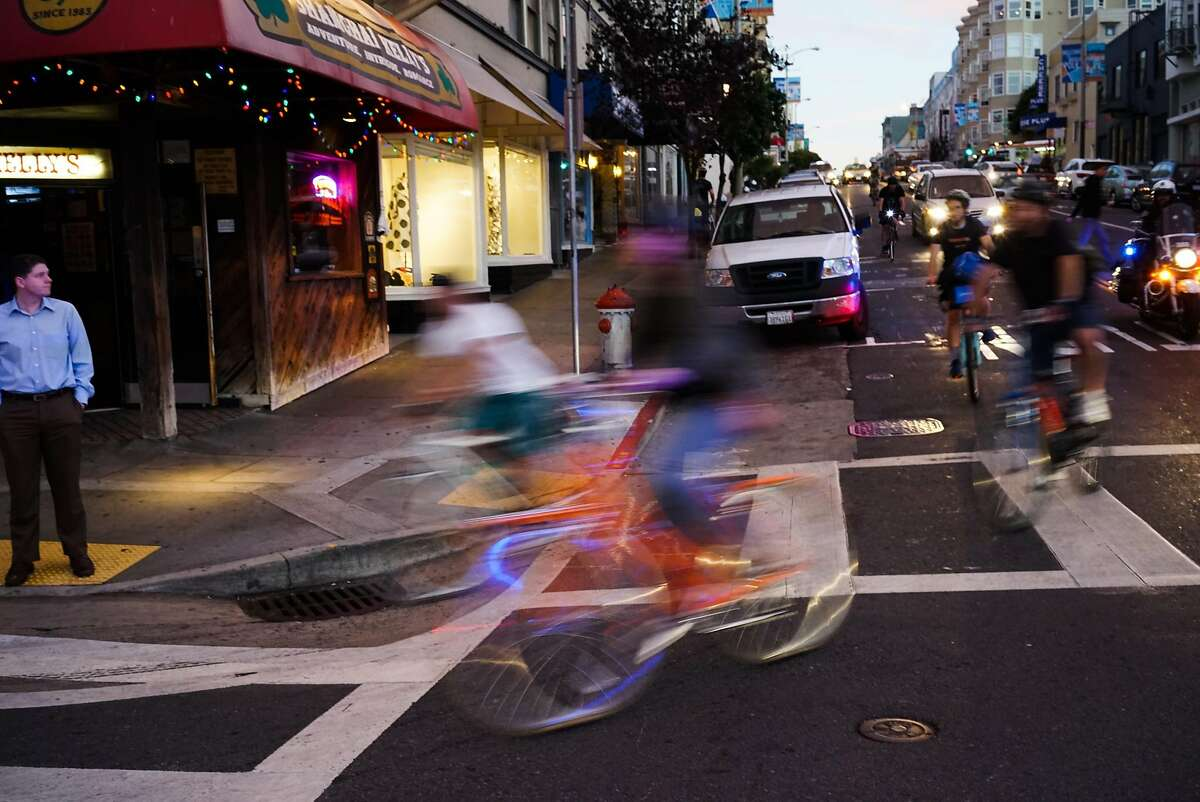 Critical Mass riders make their way through San Francisco, Calif. on Friday, Sept. 25, 2015. The monthly bike ride takes place on the last Friday of the month.