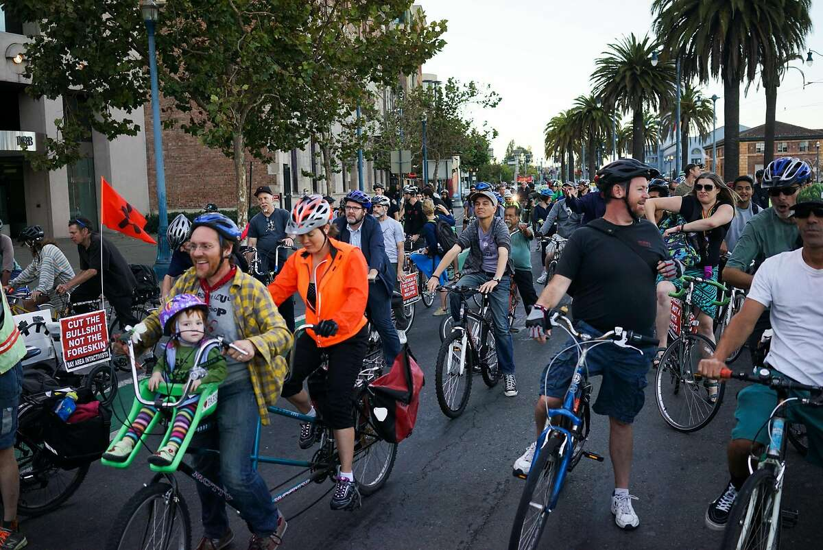 Critical Mass riders bike down the Embarcadero in San Francisco, Calif. on Friday, Sept. 25, 2015. The monthly bike ride takes place on the last Friday of the month.