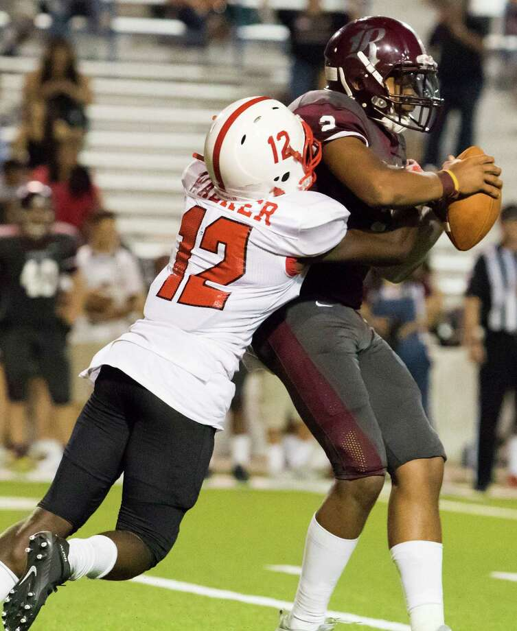 Bellaire Cardinals' defensive back Marquise Walker (12) sacks Reagan Bulldogs' quarterback Shane Johnson (2) on thrid down play to fore a punt late in the fourth quarter of a high school football game at Delmar Stadium on Friday, September 25, 2015, in Houston. Photo: Joe Buvid, For The Chronicle / © 2015 Joe Buvid