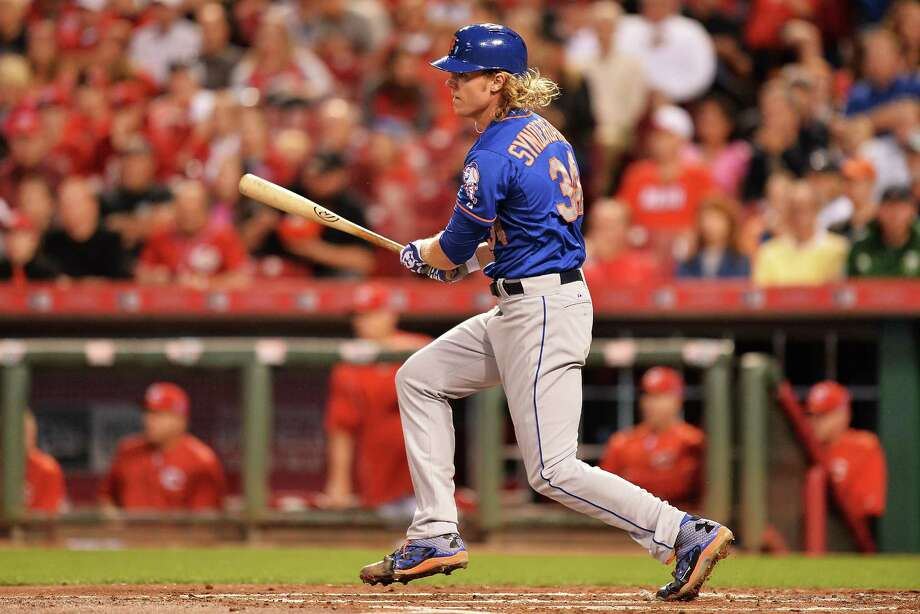 CINCINNATI, OH - SEPTEMBER 25:  Noah Syndergaard #34 of the New York Mets hits an rbi single in the second inning against the Cincinnati Reds at Great American Ball Park on September 25, 2015 in Cincinnati, Ohio.  (Photo by Jamie Sabau/Getty Images) ORG XMIT: 538595631 Photo: Jamie Sabau / 2015 Getty Images