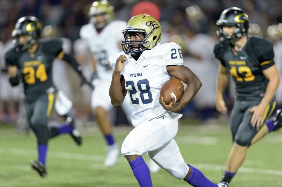 Curtis Moore (28) of the Klein Collins Tigers runs for the final touchdown in the fourth quarter in a high school football game against the Klein Oak Panthers on Friday, September 25, 2015 at Klein Memorial Stadium. Photo: Wilf Thorne, For The Chronicle / © 2015 Houston Chronicle