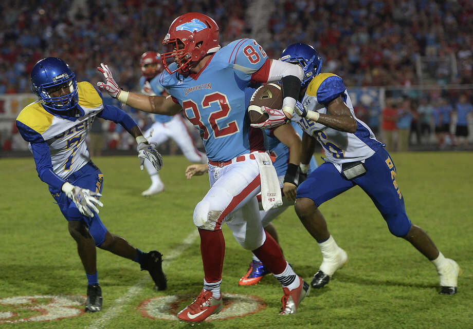 Lumberton's Mason Sikes looks to evade Ozen's Deonte Darjean (left) and Jaydon Cunigan as he picks up yardage during their district match-up Friday night in Lumberton.  Photo taken Friday, September 25, 2015  Photo by Kim Brent Photo: Kim Brent / Beaumont Enterprise