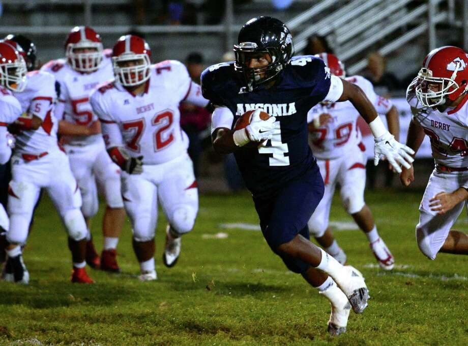Ansonia's Tajik Bagley takes off for the endzone to score, during high school football action against Derby in Ansonia, Conn. on Friday Sept. 25, 2015. Photo: Christian Abraham / Hearst Connecticut Media / Connecticut Post