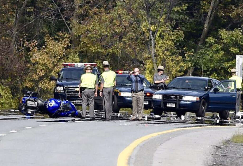 State Police investigate a motorcycle accident in the southbound lanes of Northway exit 13 Friday afternoon, Sept. 25, 2015, in Malta, N.Y. (Skip Dickstein/Times Union)