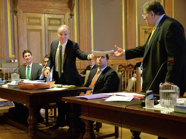 Attorney Steven Russo, center standing, hands a copy of his motion to GOPOs lawyer John Ciampoli, right, during a Women's Equality Party hearing before Albany County State Supreme Court Acting Justice Richard Platkin in Albany County Court Friday Sept. 25, 2015 in Albany, NY. (John Carl D'Annibale / Times Union) Photo: John Carl D'Annibale / 00033506A