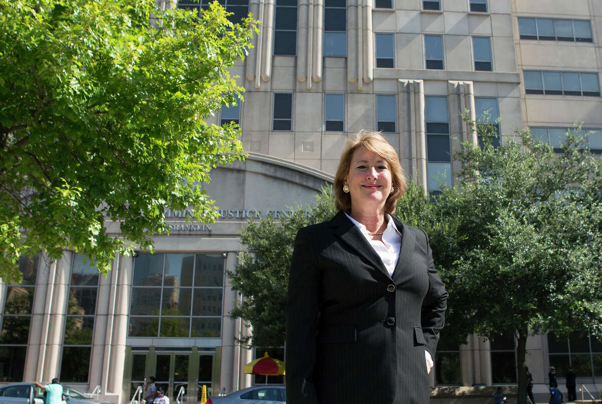 Former candidate for Harris County District Attorney Kim Ogg stands in front of the Harris County Criminal Courthouse after announcing her second run at office, Friday, Sept. 25, 2015, in Houston.