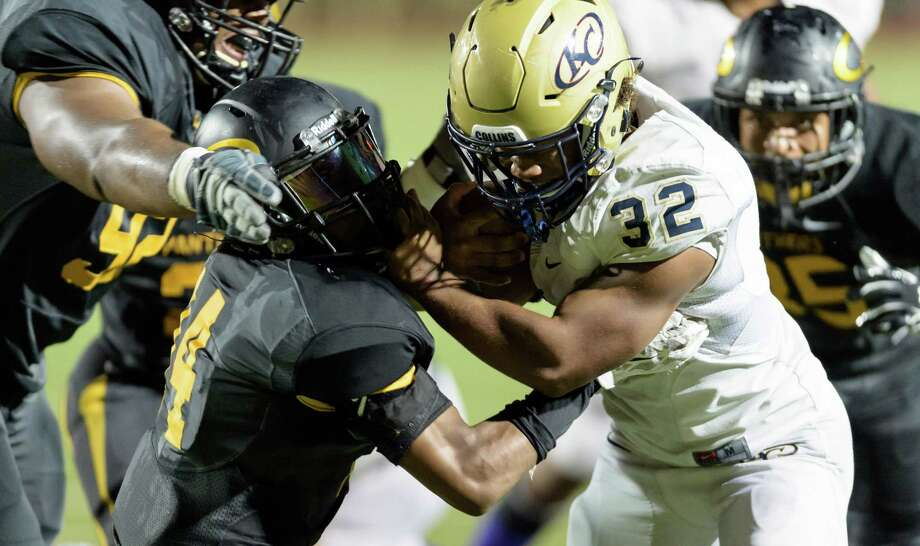 Klein Collins' Justin Pratt (32) bulls his way through the Klein Oak defense for a 9-yard touchdown in the first half. Pratt rushed for 206 yards and two TDs. Photo: Wilf Thorne / © 2015 Houston Chronicle