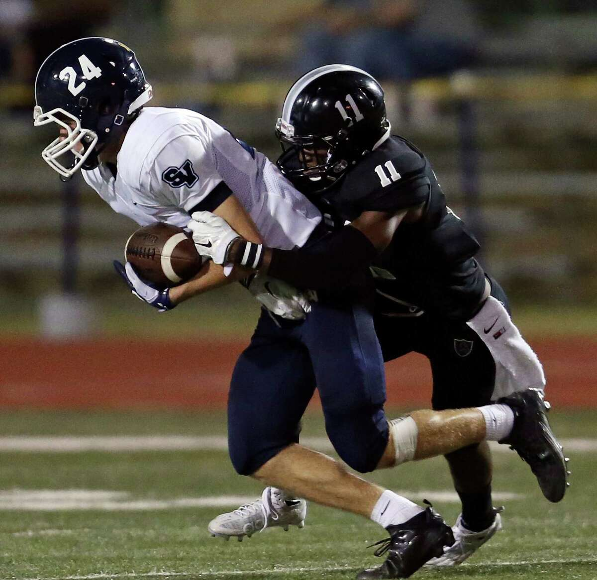 Smithson Valley's Tanner Jennings is tackled by Steele's Tavian Carter during second half action Friday Sept. 25, 2015 at Lehnhoff Stadium. Steele won 42-16.