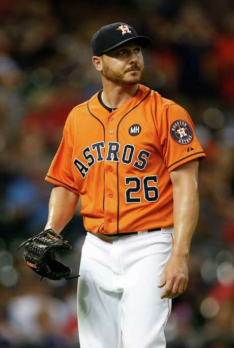 It was a short night for Astros starting pitcher Scott Kazmir, who lasted only 32⁄3 innings. He gave up six runs on 10 hits to the Rangers. Photo: Karen Warren, Staff / © 2015 Houston Chronicle
