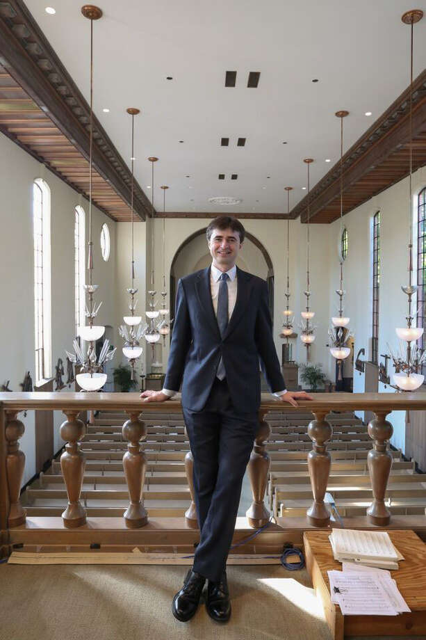 """Julian Revie, of Monroe, poses in the choir loft of St. Thomas More Chapel at Yale University in New Haven. Revie composed the """"The Love of God"""" antiphon that will be played during the Papal Mass in Philadelphia on Sunday. Photo: Ye Weon Mary Kim / Contributed Photo / Connecticut Post Contributed"""