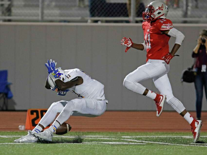 Clemens Tommy Bush reacts after dropping a wide open pass as Judson Malik Taylor follows the play in 2nd quarter. District 25-6A high school football game between Judson and Clemens at Rutledge Stadium on September 25, 2015.
