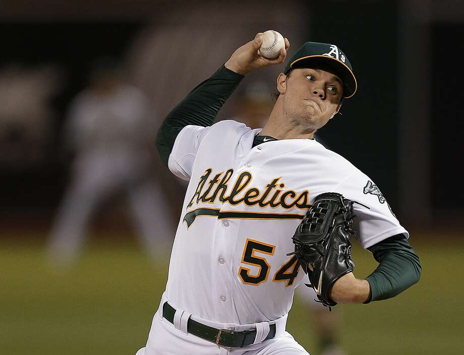 Oakland Athletics pitcher Sonny Gray works against the San Francisco Giants during the first inning of a baseball game Friday, Sept. 25, 2015, in Oakland, Calif. (AP Photo/Ben Margot) Photo: Ben Margot, Associated Press