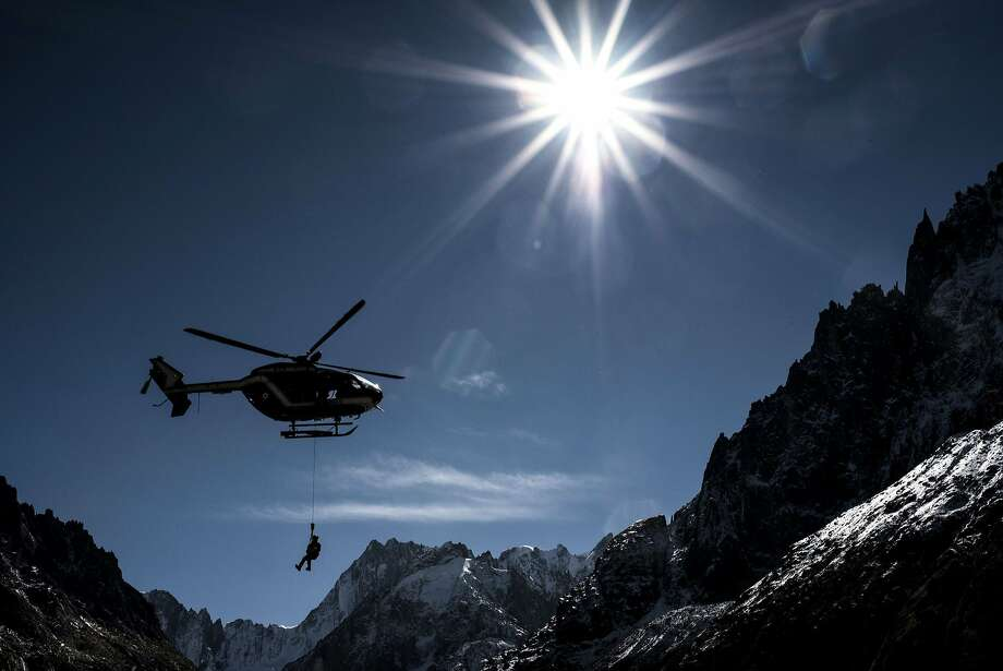 A person is rescued by a gendarmerie (PGHM) helicopter, on September 25, 2015 in Mont Blanc mountains, during a mountain rescue exercise. Photo: Jeff Pachoud, AFP / Getty Images