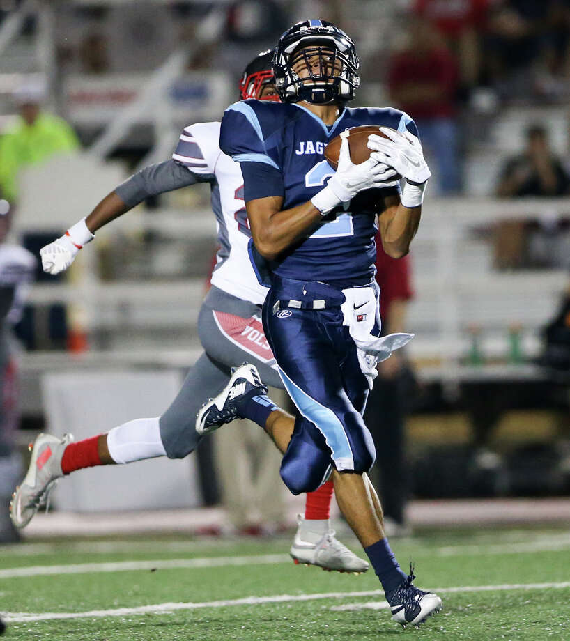Johnson's Hunter Trinidad (right) gets past Lee's Brandon Falkquay for a 79-yard catch and run touchdown on the Jaguars first play from scrimmage during their District 26-6A game at Comalander Stadium on Friday, Sept. 24, 2015.  MARVIN PFEIFFER/ mpfeiffer@express-news.net Photo: Marvin Pfeiffer, Staff / San Antonio Express-News / Express-News 2015