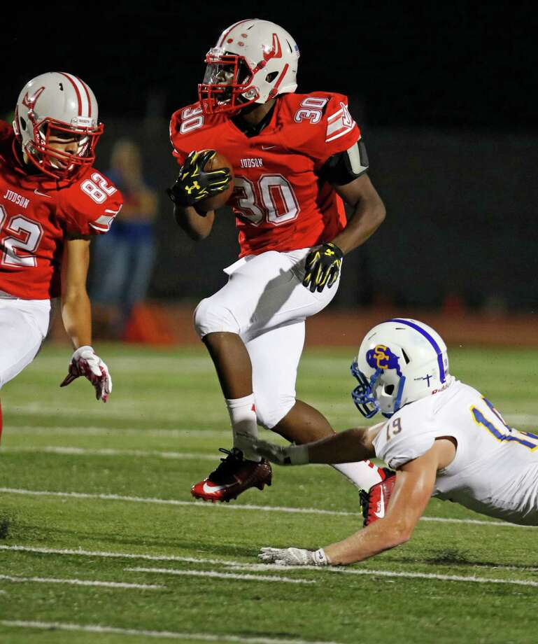 Judson Sincere McCormick avoids the tackle of Clemens Bryan Larson to score the first TD. District 25-6A high school football game between Judson and Clemens at Rutledge Stadium on September 25, 2015. Photo: Ron Cortes, Freelance / For The San Antonio