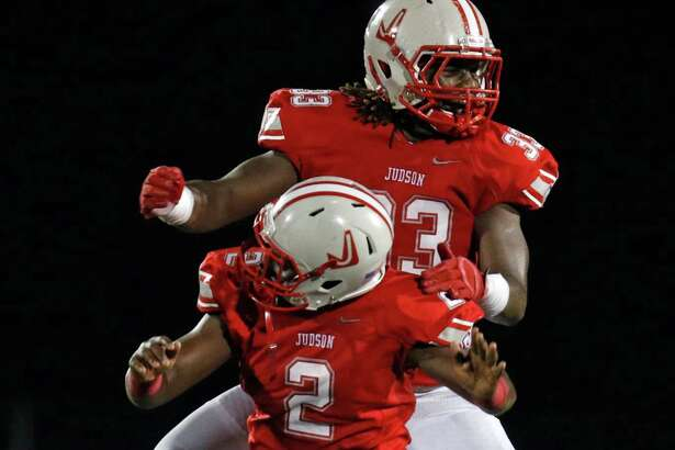 Judson's Julon Williams celebrates with Xavier Morris,in back after a 4th quarter defensive stop. District 25-6A high school football game between Judson and Clemens at Rutledge Stadium on September 25, 2015.