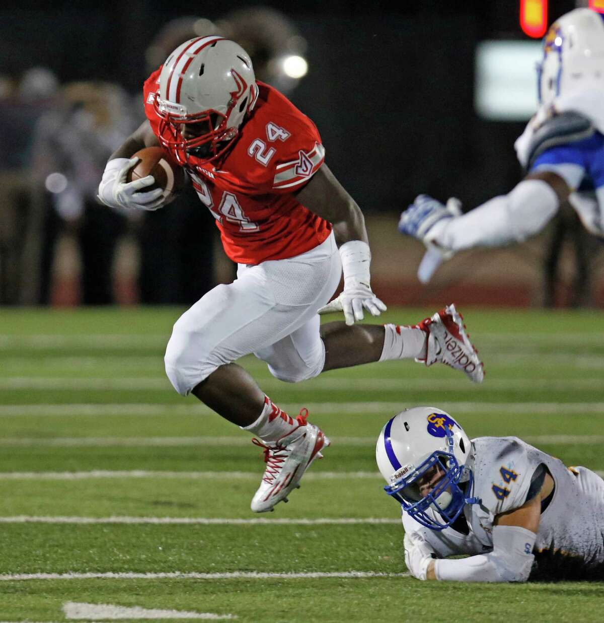 Judson Mi'Kel Jackson leaps out of the grasp of Clemens' Luke Jennings in the second quarter during a District 25-6A game between at Rutledge Stadium on Sept. 25, 2015.