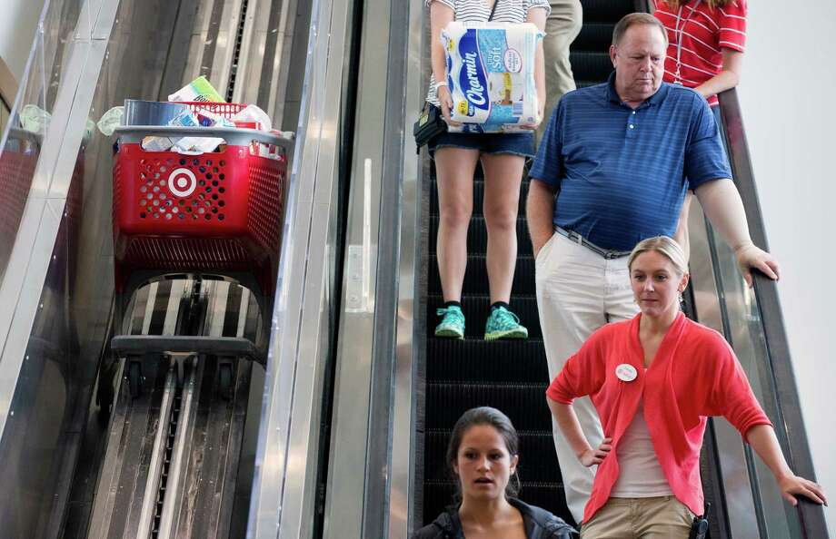 In this Aug. 21, 2015 photo, shoppers ride an escalator beside a special one for shopping carts in the CityTarget store in Boston. The University of Michigan issues its monthly index of consumer sentiment for September on Friday, Sept. 25, 2015. (AP Photo/Michael Dwyer) Photo: Michael Dwyer, STF / AP