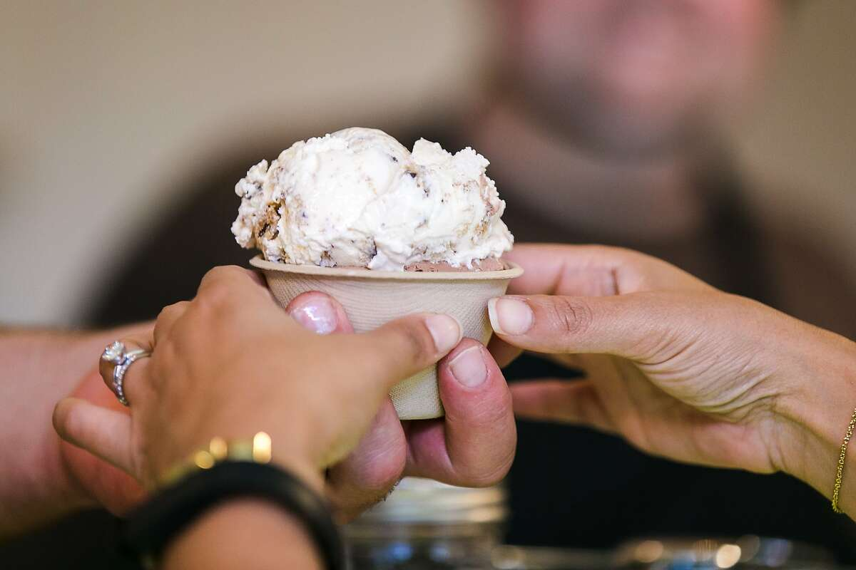 A cup of ice cream is handed to a customer at Shakedown inside San Francisco's Tenderloin District.