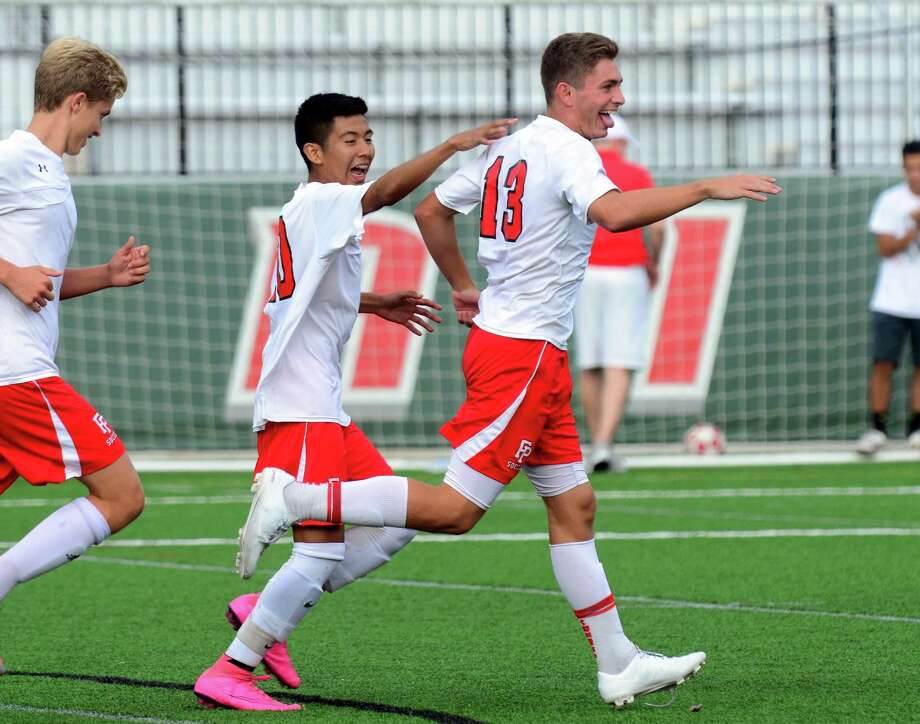 Fairfield Prep's Biagio Paoletta (13) celebrates after scoring a goal during in the Jesuits 3-1 win over Guilford on Tuesday. Prep improved to 4-0 with the victory. Photo: Christian Abraham / Hearst Connecticut Media / Connecticut Post
