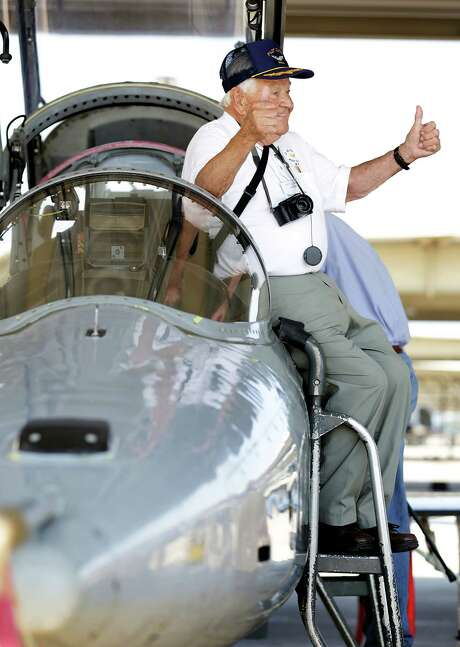 Theodore Turek, an Army Air Corps veteran and member of the Pilot Classes of WWII Reunion group, has his photo taken by a T-38 trainer as reunion attendees tour Joint Base San Antonio-Randolph on Friday. Photo: Photos By Bob Owen /San Antonio Express-News / San Antonio Express-News