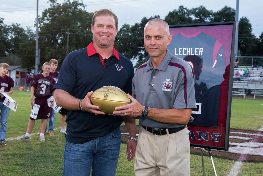 Texans punter Shane Lechler returned to his alma mater East Bernard High School to present head coach Jerry Long and the Brahmas with the NFL's Golden Ball as part of the celebration leading up to Super Bowl 50. Photo: Courtesy Houston Texans / © 2015 Michelle Watson. All rights reserved.
