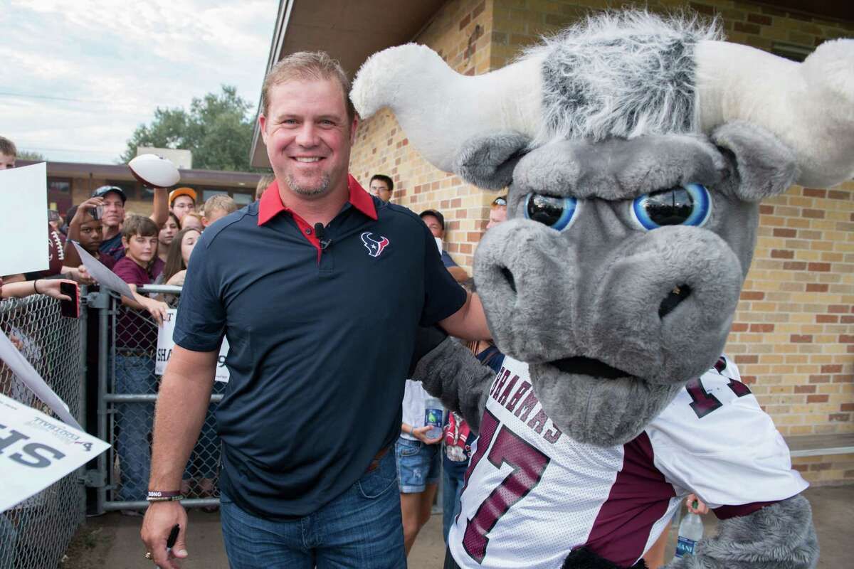 September 25, 2015; EAST BERNARD, TX -- Houston Texans punter Shane Lechler returns to his alma mater East Bernard High School to present his school with the NFL's Golden Ball as part of the celebration leading up to Super Bowl 50.