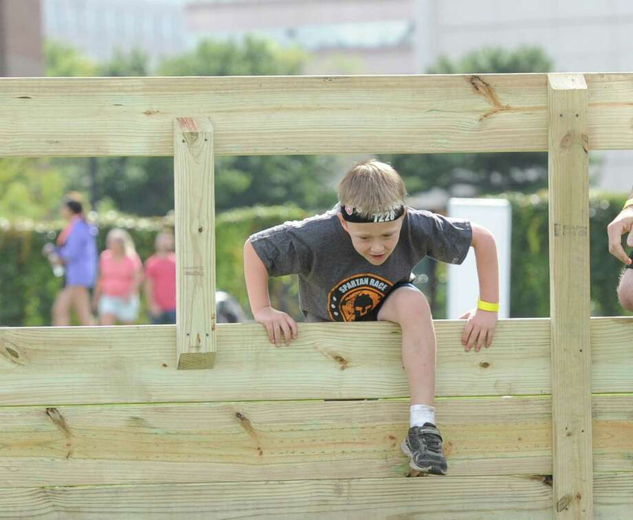 The Spartan Kids races in Mill River Park in Stamford, Conn., Saturday, Sept. 26, 2015. The races, for children 5-12 years of age, featured 2K and 4K heats with 15 course obstacles that included a ten-foot netted climbing wall. Photo: Bob Luckey Jr., Hearst Connecticut Media / Greenwich Time