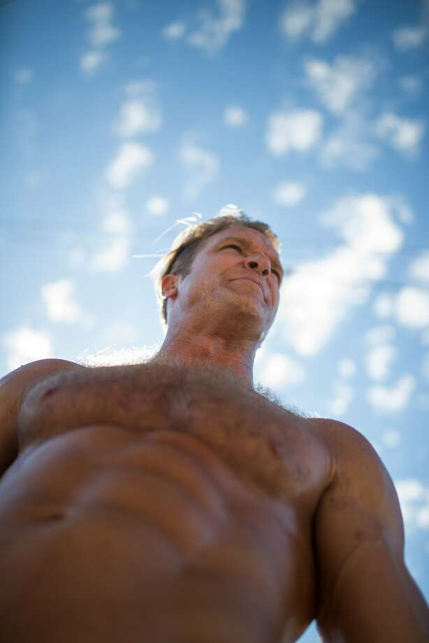 Brent Fraser, a performer from Canada, does exercises in the nude at a nudist rally on Saturday, Sept. 26, 2015 in San Francisco, Calif.  Nudists hold a nude-in at Jane Warner Plaza in the Castro after a San Francisco judge ruled the city had to issue them a permit. Photo: Nathaniel Y. Downes, The Chronicle