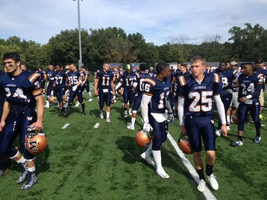The Western Connecticut State University football team leaves the field after losing 39-34 to Framingham State on Sept. 26, 2015. Photo: By Jon Chik / - / Connecticut Post