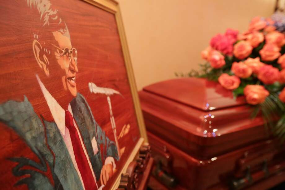 The casket of Milo Hamilton is seen during a public memorial at Geo. H. Lewis & Sons funeral home, Saturday, Sept. 26, 2015, in Houston. Hamilton, who called play-by-play action for seven MLB teams in his career, joined the Astros in 1985 and retired in 2012. Photo: Houston Chronicle