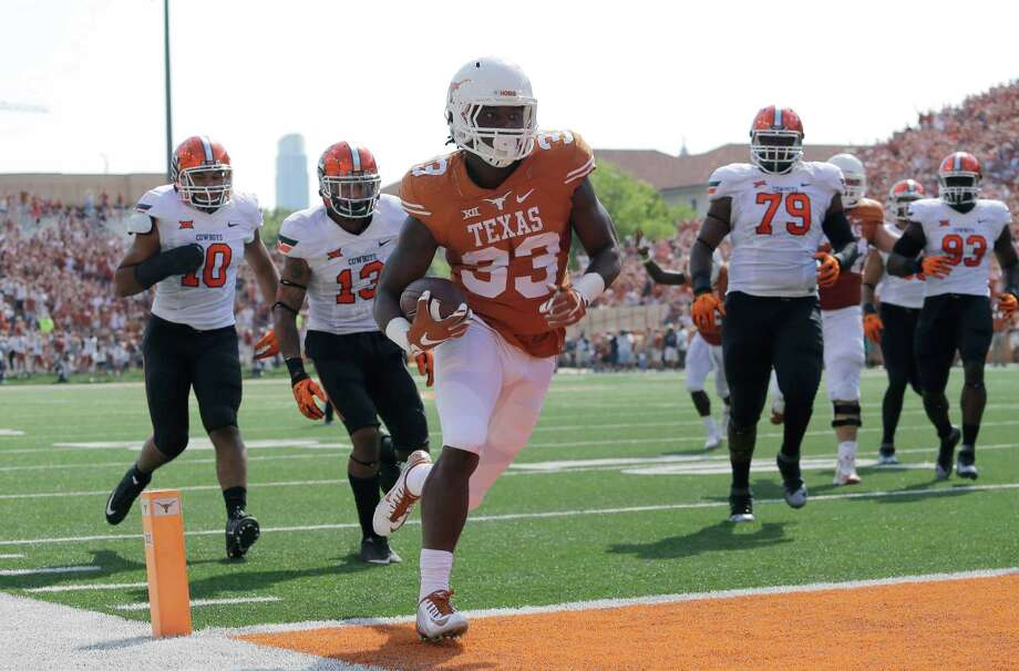 Texas' D'Onta Foreman (33) scores a touchdown against Oklahoma State during the first half of an NCAA college football game, Saturday, Sept. 26, 2015, in Austin, Texas. (AP Photo/Eric Gay) Photo: Eric Gay, Associated Press / AP