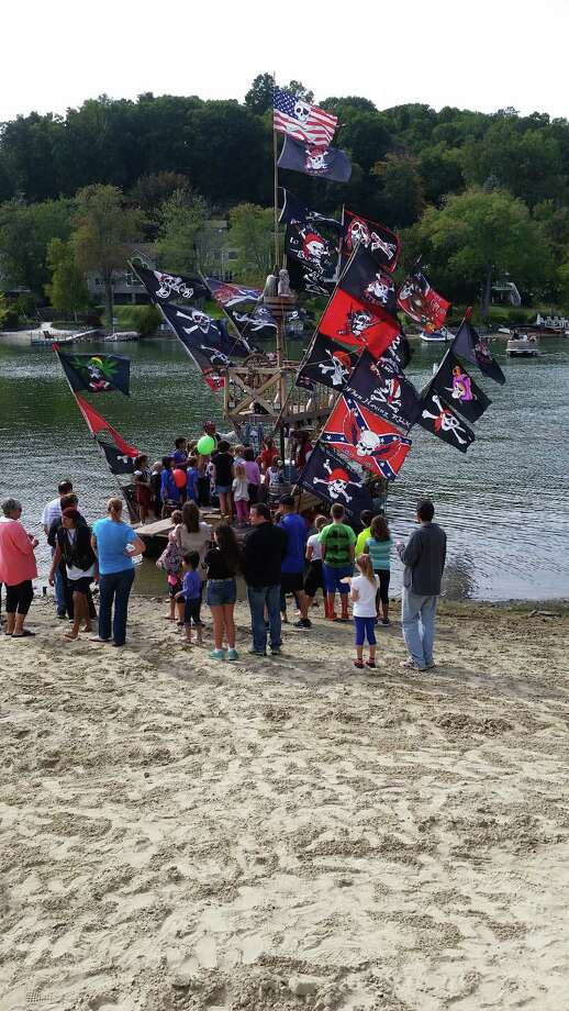 Brookfield residents flocked to the pirate ship as it arrived on the shore of Brookfield Town Park on Candlewood Lake at the park's ribbon cutting ceremony on Saturday, Sept. 26, 2015. Photo: Alex Wolff / Hearst Connecticut Media