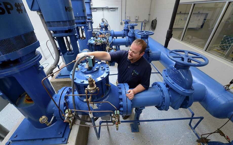 Manager Jeremy Lollar makes sure everything is OK at a water treatment plant in Noblesville, Ind. The EPA says it will cost $6.5 billion over 20 years just to maintain the state's infrastructure.  Photo: Matt Kryger, MBR / The Indianapolis Star