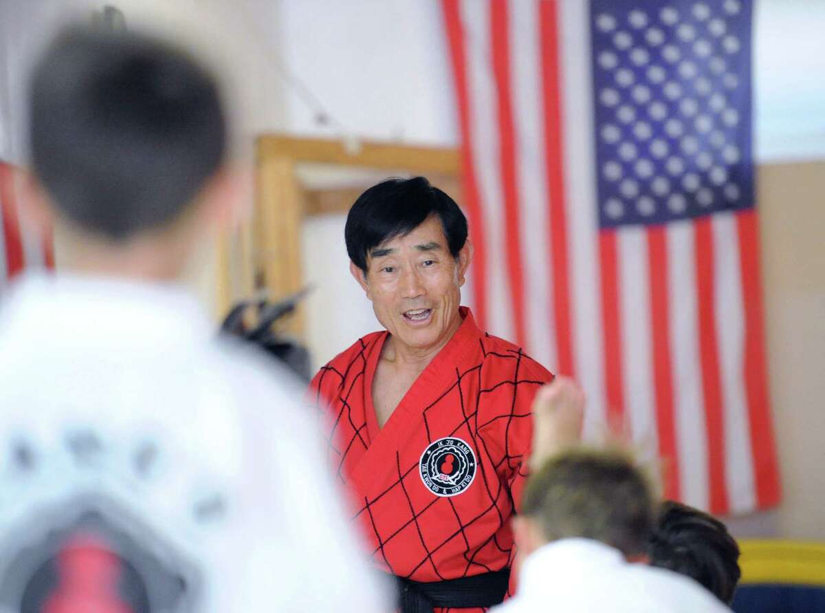 Grand Master Kang, a marital arts master, teaches a class in tae kwon do at his studio in Old Greenwich Friday. Ik Jo Kang is the subject of an upcoming film about his life. He has been teaching martial arts for over 40 years.