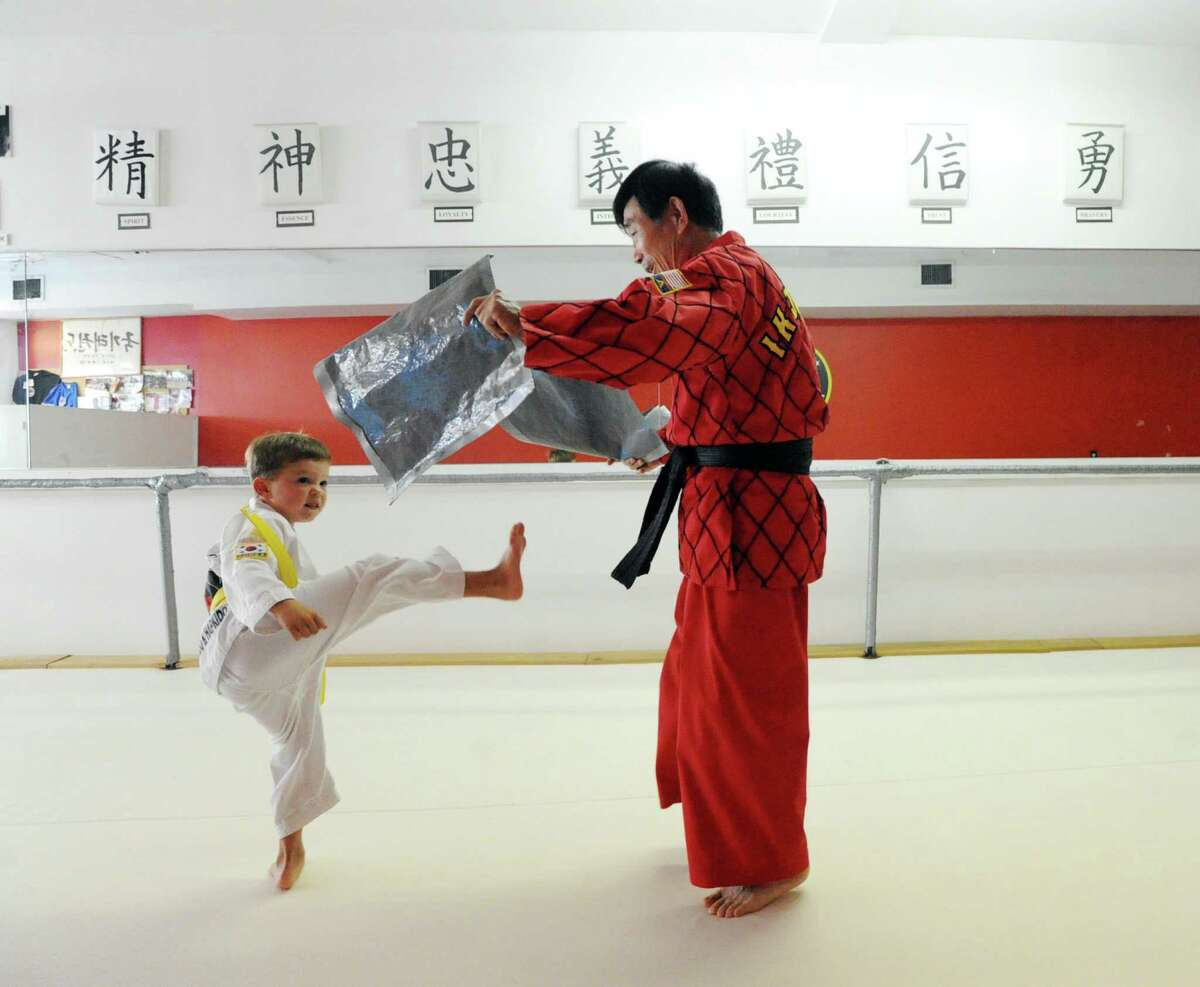 At right, Grand Master Kang, a marital arts master, works with student Robert Lang, 5, of Old Greenwich, while teaching a class in Tae Kwon Do at his studio in Old Greenwich, Conn., Friday, Sept. 25, 2015. Ik Jo Kang is the subject of an upcoming film about his life. He has been teaching martial arts for over 40 years.