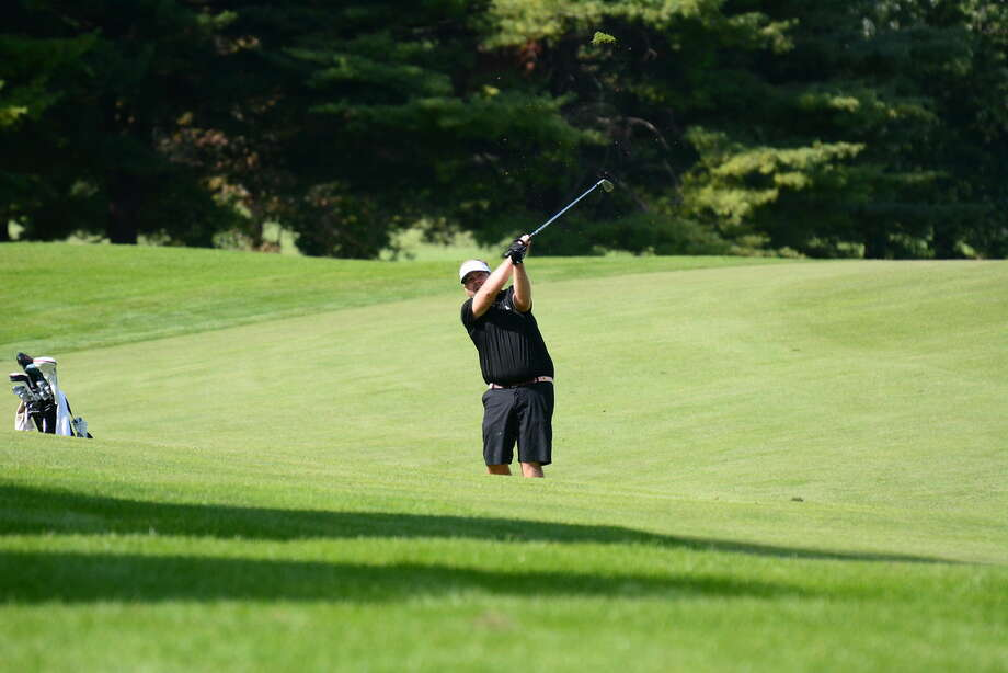 Jamie Miller of Wanakah hits a shot in the second round of the New York State Mid-Amateur at Wolferts Roost on Saturday, Sept. 26, 2015. (Andrew Hickey / NYSGA)
