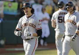 Giants' Jarrett Parker with a grand slam in the 8th inning to put the Giants up 14-10 as the San Francisco Giants take on the Oakland Athletics at O.co Coliseum, Calif. on Sat. September 26, 2015.
