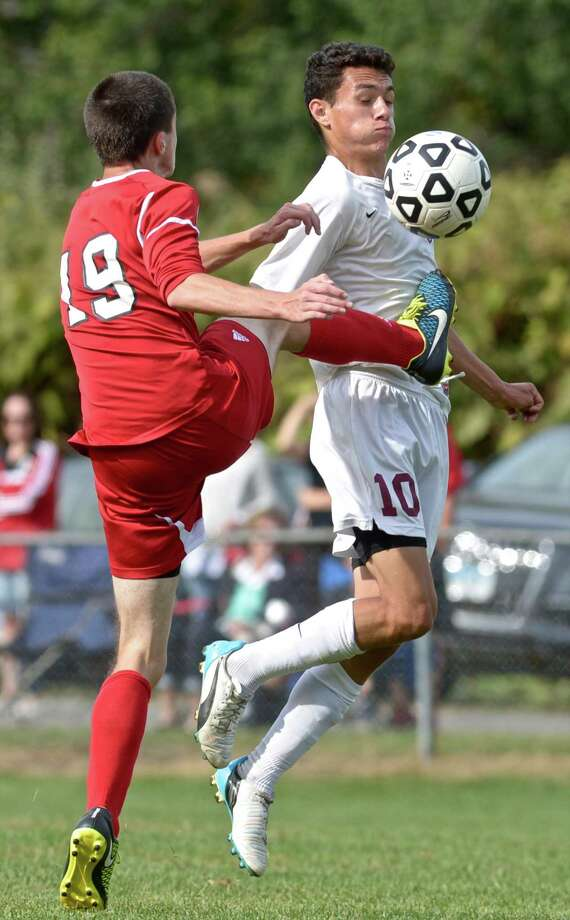 Masuk's Nathan Dablain (19) and Bethel's Frank Musser (10) both go for the ball in boys high school soccer game between Masuk and Bethel high schools on Saturday, September 26, 2015, at Rourke Field, in Bethel, Conn. Photo: H John Voorhees III / Hearst Connecticut Media / The News-Times