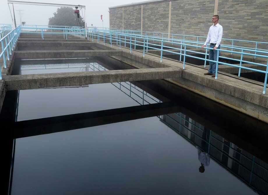 Chris Wheland checks outdoor filtration tanks at the City of Troy Water plant Wednesday morning Sept. 23, 2015 in Troy, N.Y.   (Skip Dickstein/Times Union) Photo: SKIP DICKSTEIN / 00033435A
