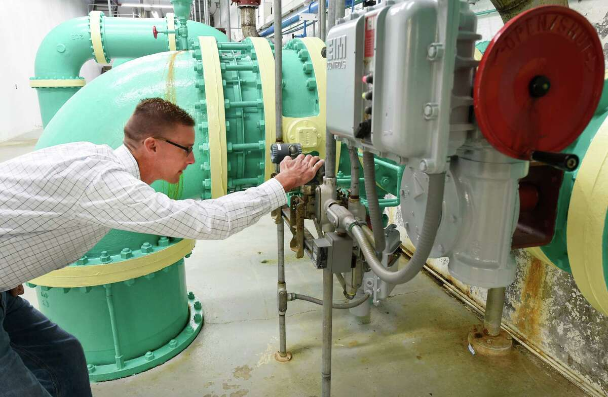 Chris Wheland checks meters in the City of Troy Water plant Wednesday morning Sept. 23, 2015 in Troy, N.Y. (Skip Dickstein/Times Union)