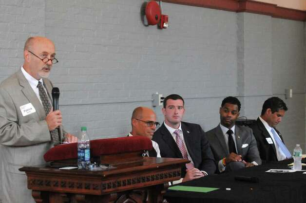 Cadidate Patrick Madden, left, speaks during a mayoral brown bag discussion with all five mayoral candidates Democrats: Ernest Everett, Rodney Wiltshire and Patrick Madden who are in a primary, Republican Jim Gordon and Rveolutionary Party Jack Cox Jr. at the YWCA on Thursday Aug. 20, 2015 in Troy, N.Y.  (Michael P. Farrell/Times Union) Photo: Michael P. Farrell / 00033033A