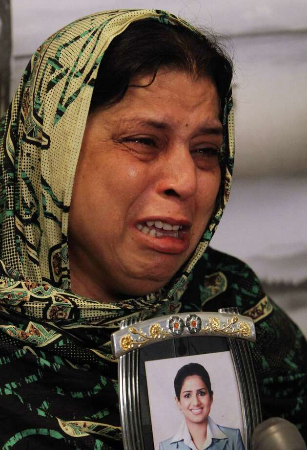 Pakistani mother, Sarwari Begum, shows a picture of her daughter, Bushra Khalique, 27, who is reportedly missing after a crush during the Hajj pilgrimage in Saudi Arabia, Saturday, Sept. 26, 2015 in Karachi, Pakistan. As the hajj religious pilgrims entered its final day Saturday, officials in Saudi Arabia continued to grapple with the aftermath of a deadly stampede that killed at least 750 people. (AP Photo/Fareed Khan) ORG XMIT: ISL110 Photo: Fareed Khan / AP