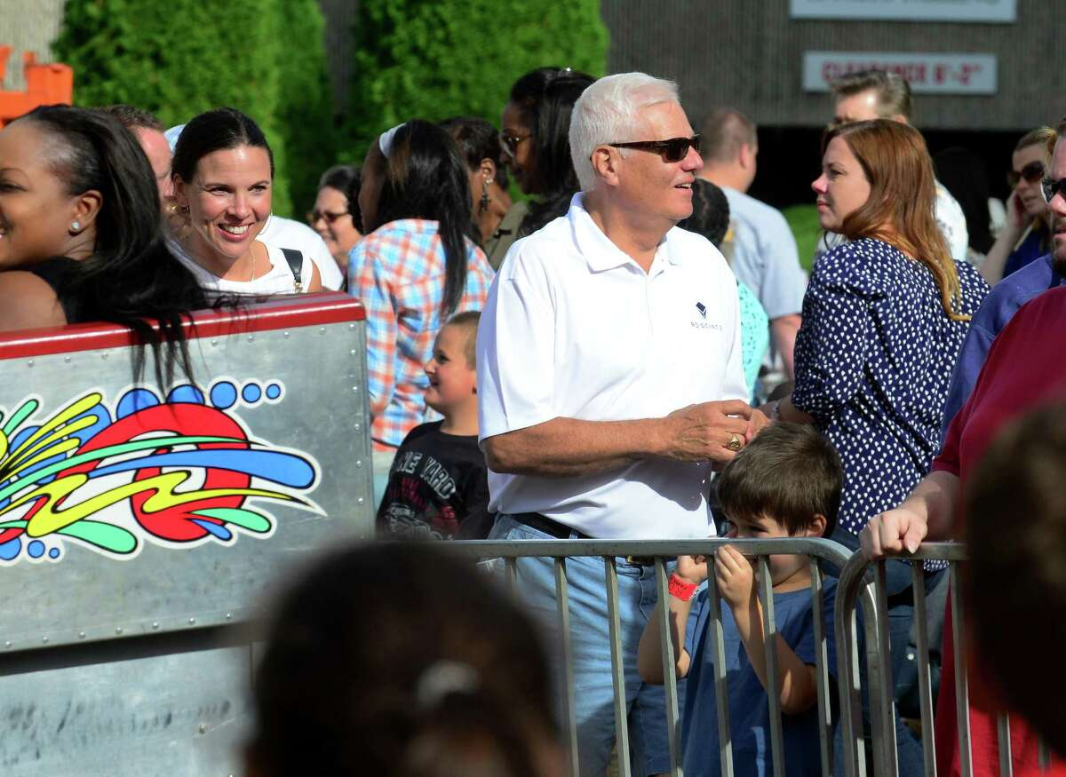 J.D. Scinto strolls through to check out the rides at his First Annual R.D. Scinto Family Day Carnival at Scinto Towers in Shelton, Conn. on Saturday Sept. 26, 2015. All money raised will be donated to local charities. Fifty percent will be donated to the Valley United Way and fifty percent will go to the Bridgeport Rescue Mission.