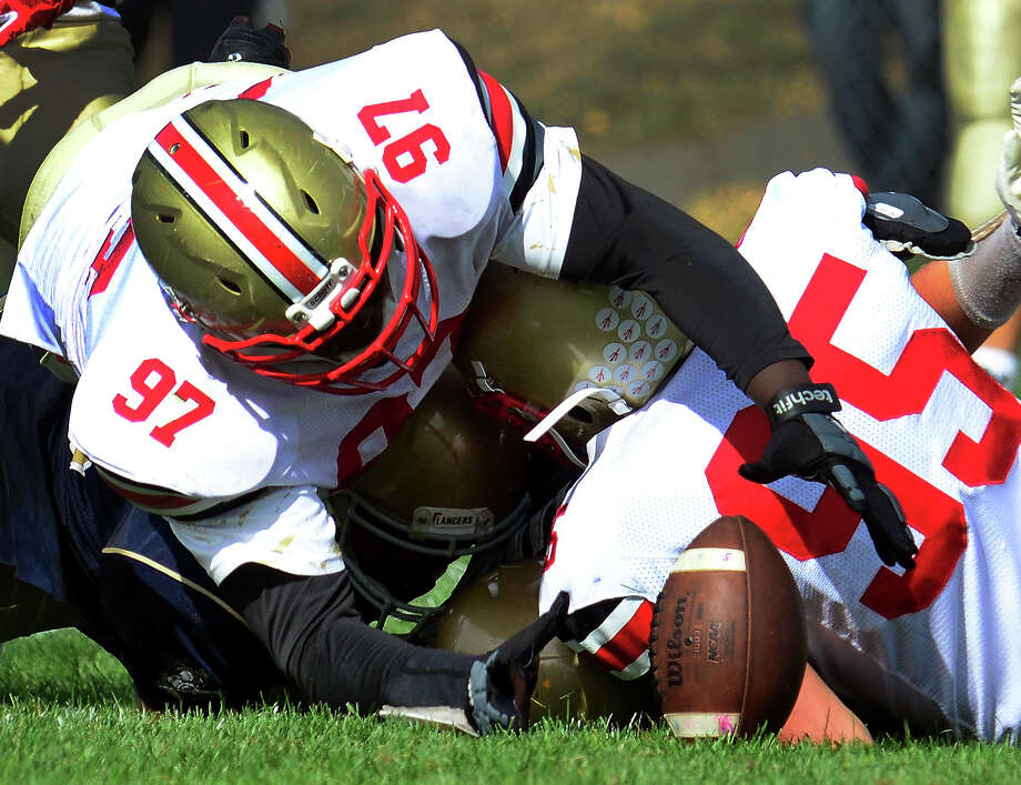 Stratford's Quintin Rollins is ready to pounce on a Notre Dame of Fairfield fumble in Saturday's game. Stratford rallied for a 21-19 win to improve to 3-0, its best start since 2007. Photo: Christian Abraham / Hearst Connecticut Media / Connecticut Post