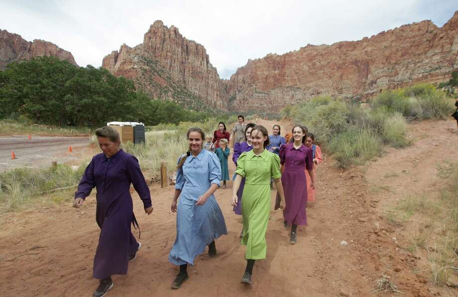 Community members head to a memorial service Saturday in Hildale, Utah - hosted by two polygamous towns on the Utah-Arizona border-  for 12 women and children swept away in a deadly flash flood nearly two weeks ago.  Also killed in the flooding were seven hikers in Mount Zion National Park. Photo: Rick Bowmer, STF / AP