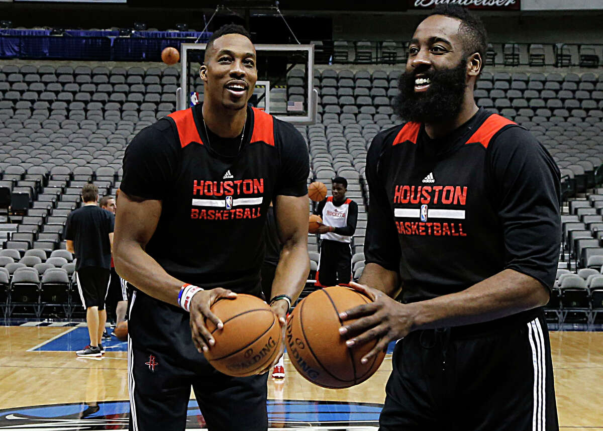 Center Dwight Howard, left, who battled fluid buildup in his knee last season but will be ready for training camp when it begins Tuesday, and guard James Harden remain the cornerstones of the Rockets.