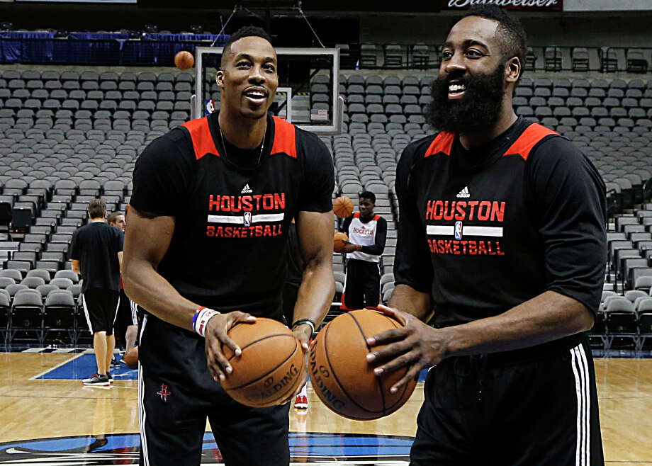 Center Dwight Howard, left, who battled fluid buildup in his knee last season but will be ready for training camp when it begins Tuesday, and guard James Harden remain the cornerstones of the Rockets. Photo: James Nielsen, Staff / © 2015  Houston Chronicle